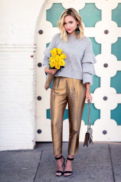 gray ruffle sleeve crew sweater with gold high waist ankle chinos