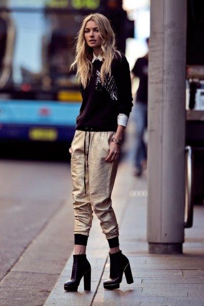 black sweater with white collar shirt and metallic jogging pants