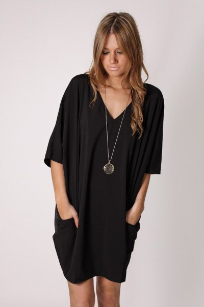 black half sleeve side pocket v-neck tunic dress