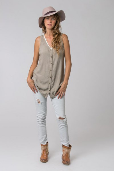 gray v-neck button-up tunic with white ripped skinny jeans