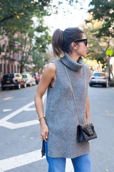 gray turtleneck sleeveless ribbed tunic with blue straight jeans