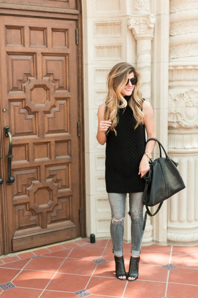 black sleeveless turtleneck tunic with gray ripped skinny jeans