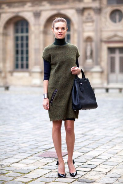 gray tunic dress over black sweater neck shirt