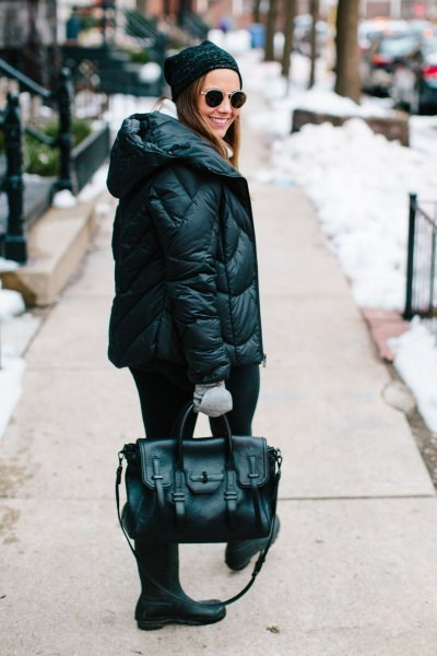 black down jacket with knitted hat and mid calf boots