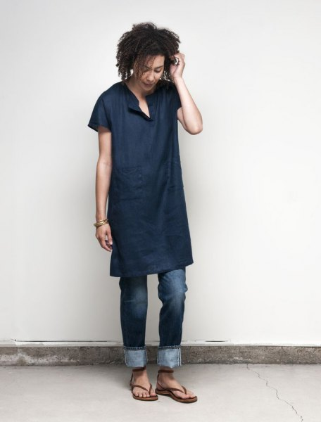 navy blue tunic shirt with dark cuffed jeans