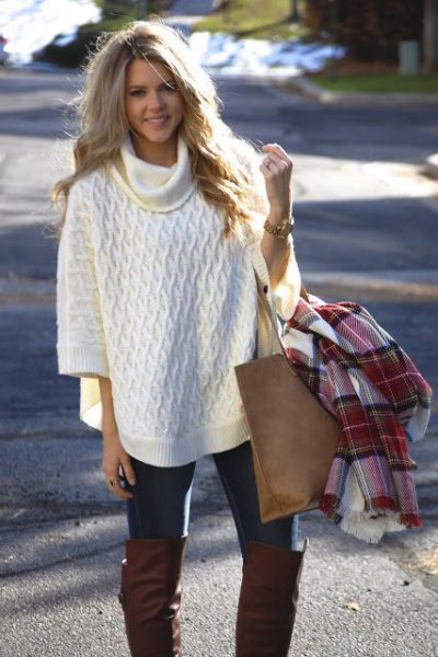 white turtleneck half-heated poncho sweater with black skinny jeans
