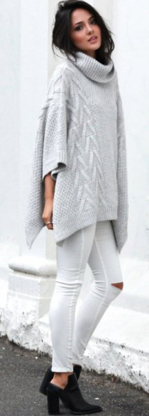 gray turtleneck cable knit poncho sweater with white ripped skinny jeans