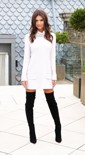 white long sleeve sweater with cabbage neck with high suede boots in the thigh