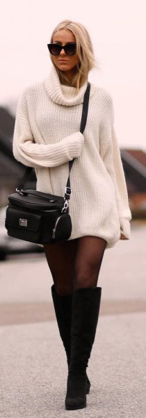 ribbed white sweater dress with black socks and high-heeled boots at the knee