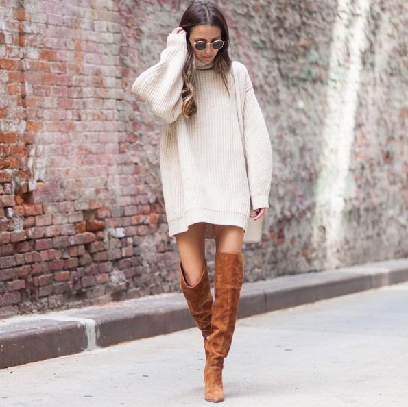 white large sweater with high suede camel boots