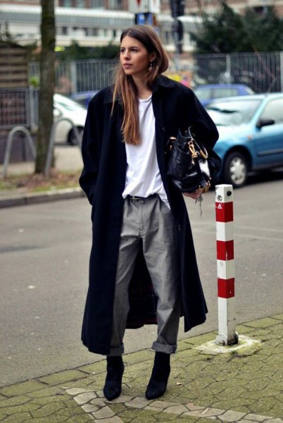 long black wool coat with white sweater and gray straight leg pants