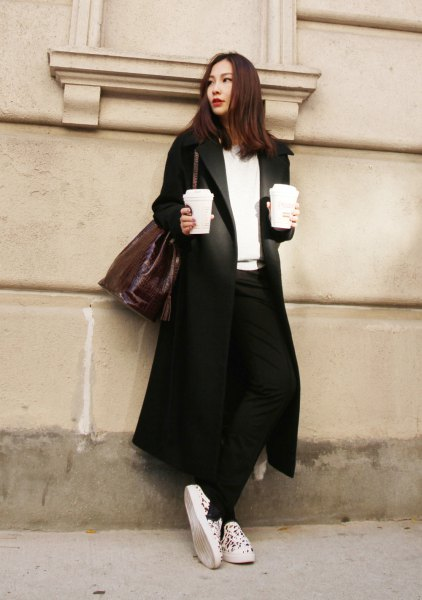 black longline blazer skirt with white v-neck sweater and canvas sneakers