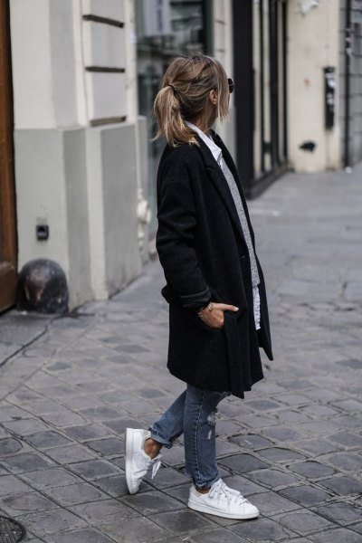 black long coat with gray sweater and white button up shirt