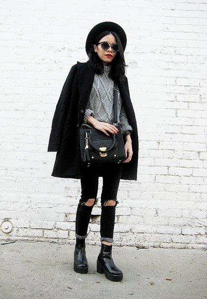 black wool coat with gray knitted sweater and ripped jeans