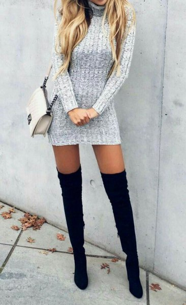 gray turtleneck long sleeve form fitting mini sweater dress with thigh high black high heels boots