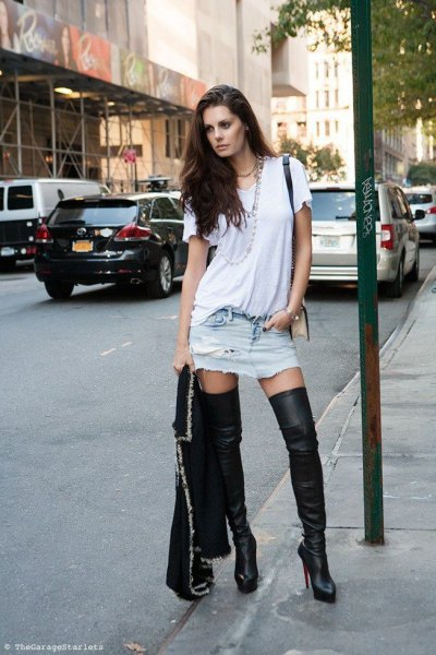 white casual fit t-shirt with mini-ripped denim skirt and high leather thighs