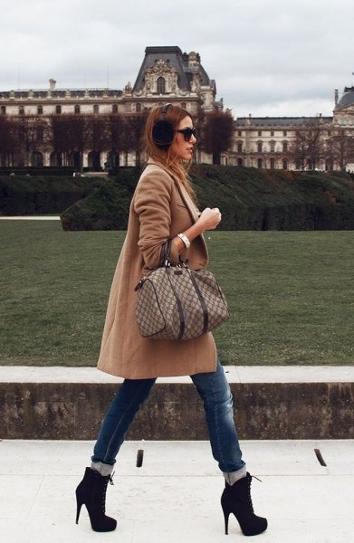 blush pink long wool coat with cuffed skinny blue jeans and heeled ankle boots