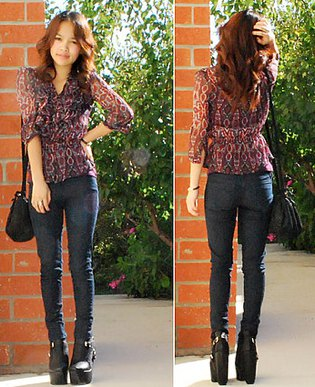 black chiffon semi sheer blouse with dark skinny jeans and high heeled ankle boots
