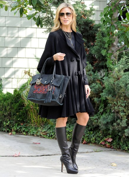 black extended knee length wool dress with leather heeled boots