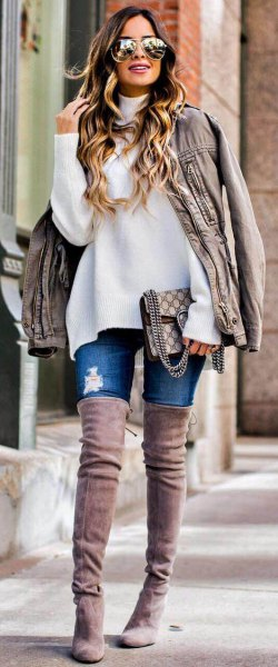 white chunky sweater with light gray oversized leather jacket and high suede boots in the thigh