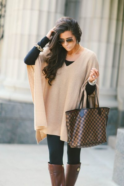 ivory with ribbed cape sweater with black leggings and gray over knee-high boots