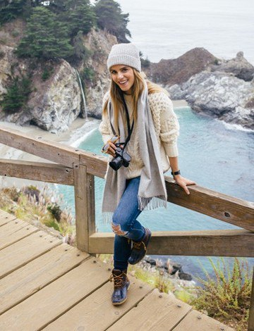 gray knitted hat with white crocheted sweater and ripped jeans