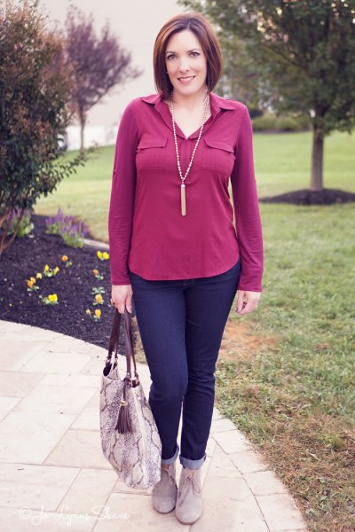 pink blouse with navy blue cuffed jeans and gray suede ankle boots
