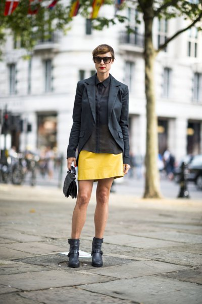 black blazer with yellow leather mini skirt and ankle boots in ankle
