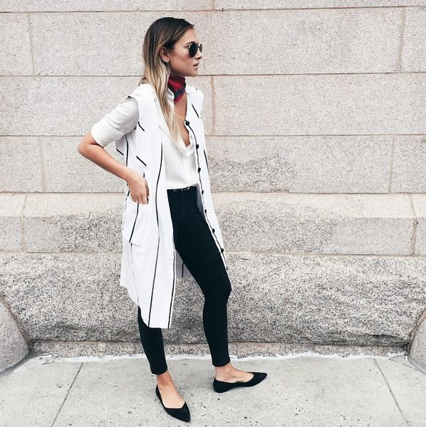 white long-line vest with long cut blouse and black pointed flats