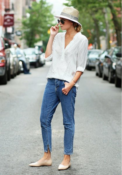 straw hat with gray and white striped button up shirt and mom jeans