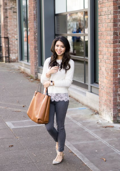 white fitted sweater with lace blouse and light pink, pointed flats