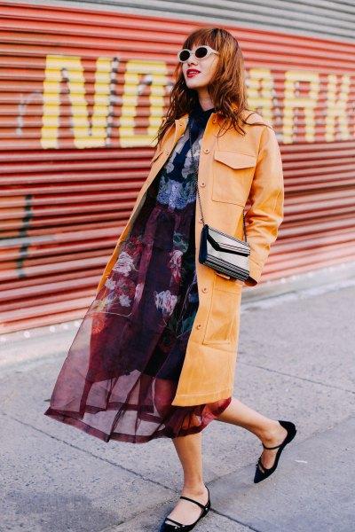 mustard yellow leather midi jacket with black midi chiffon dress and velvet flats