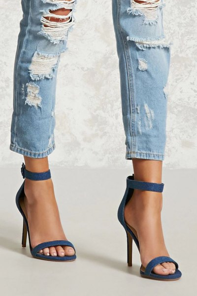 heavily ripped ankle slim fit jeans and blue ankle strap open toe denim heels