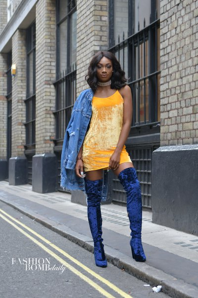yellow mini shift dress with denim jacket and blue velvet high boots