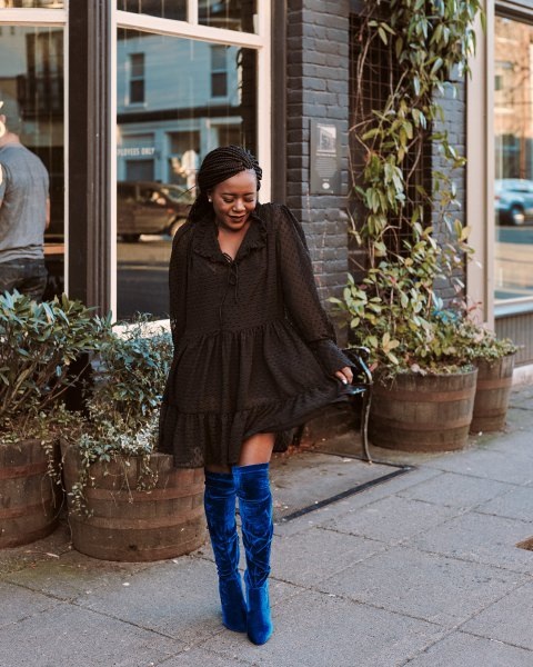 black mini ruffle long sleeve dress with blue velvet thigh high boots