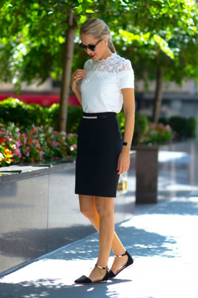 white mock neck lace short sleeve top with black high-rise skirt