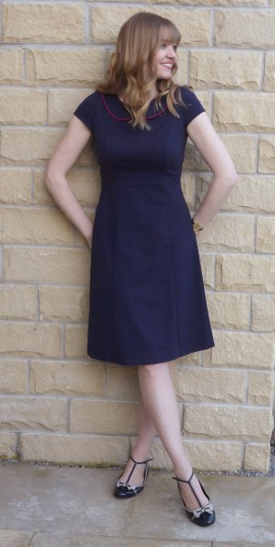 navy blue short-sleeved fit and floral knee-length dress with striped flats