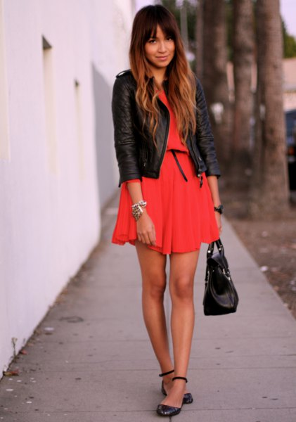 orange mini-pleated dress with black leather jacket and leather leather in the ankle