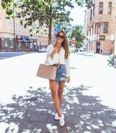 white v-neck blouse with light blue torn skirt