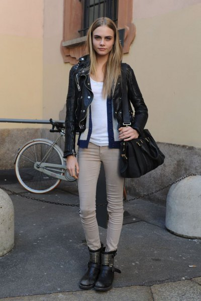 black moto jacket with light gray skinny jeans and leather bike ankle boots