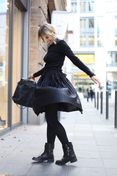 black sweater with matching leather-wrapped midi skirt and motorcycle boots