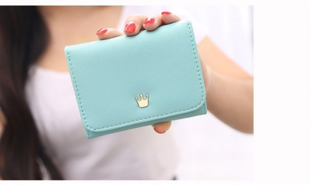 light blue small cute purse with white t-shirt and blue denim mini skirt