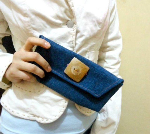 light yellow button up linen blouse with blue denim mini bag
