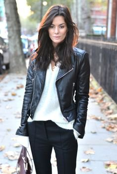cycling jacket with white v-neck sweater and black chinos
