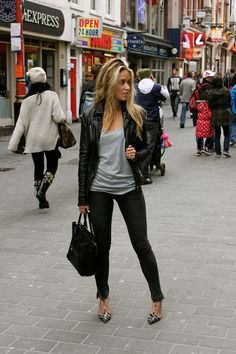 leather jacket with gray top with shoe neck and slim jeans