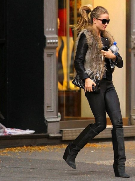 fur coat brown vest with black leather jacket with high wedge boots in the knees