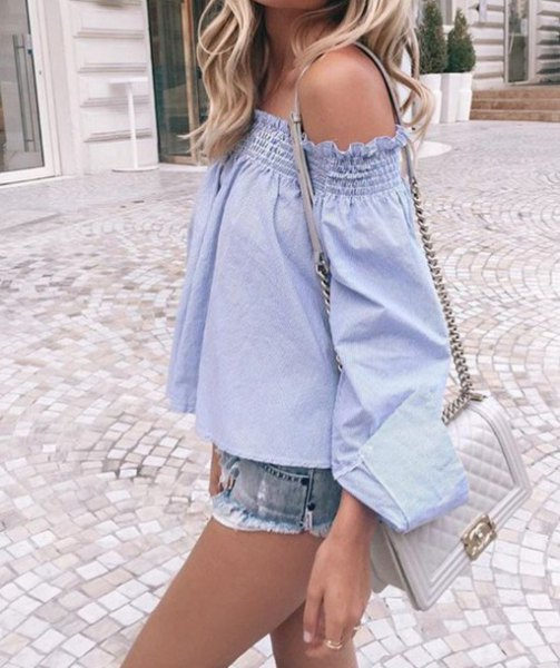 from the shoulder's light blue blouse with mini denim shorts and light pink handbag