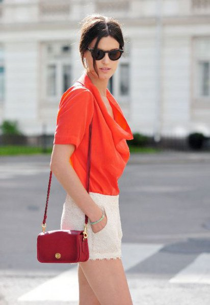 red blazer blouse with small brown leather handbag