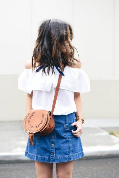 white from the shoulder blouse with blue mini denim skirt