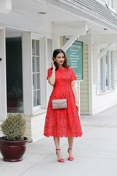 orange short sleeved midi blown lace dress with pink pink small handbag